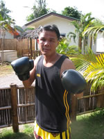champion fighter and trainer: Kroo Bom