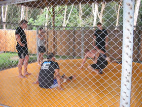 Training MMA in aa fighting cage in Phuket, Thailand.