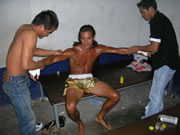 pre-fight preperation by Muay Thai trainers.