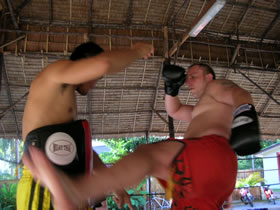 Grappling instructor works on his stand-up fight game.