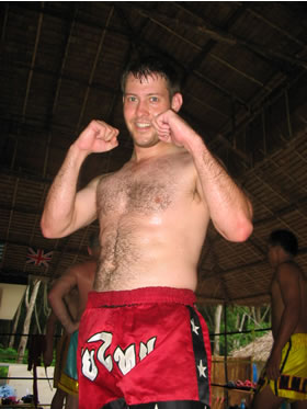 Poilce man training Muay thai in Phuket, Thailand.