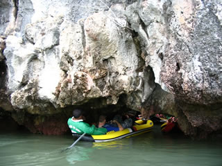 caves and waterfalls are explored on a river trip in Phuket, Thailand.