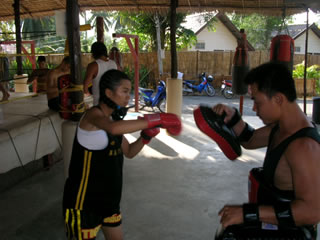 young women's muay thai fighter.